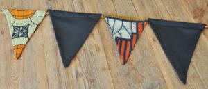 wimpelkette schwarz orange tanzania ethnisch / black orange ethnic