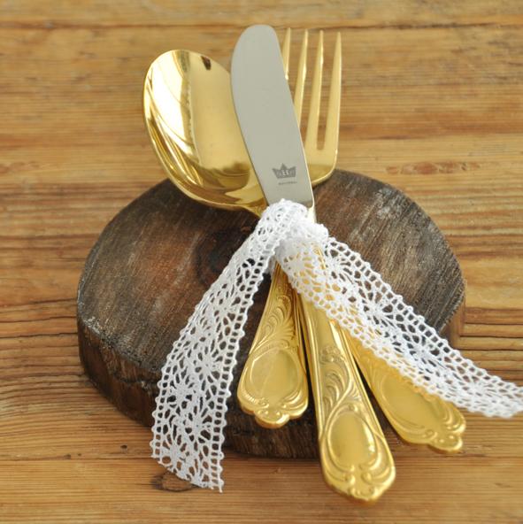Crockery and decor hire Berlin. Zebra Rose. gold plated cutlery